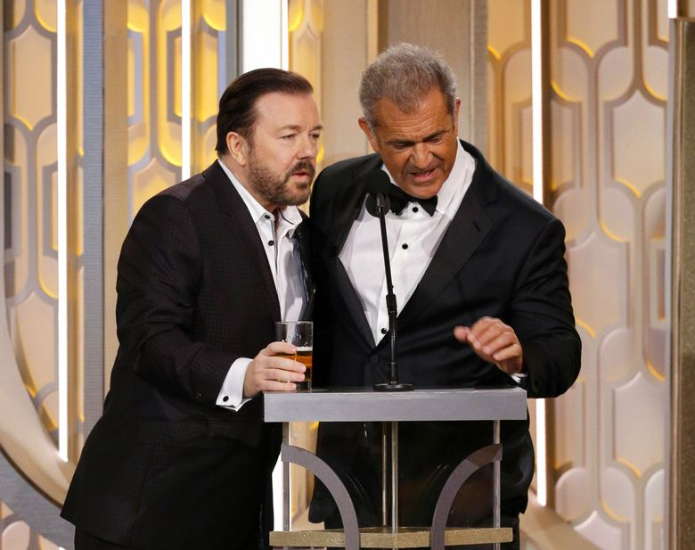 Host Ricky Gervais, left, and presenter Mel Gibson appear on stage at the 73rd Annual Golden Globe Awards. (Paul Drinkwater/The Associated Press)