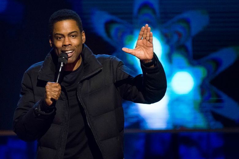 """In this Feb. 28, 2015, file photo, Chris Rock appears onstage at Comedy Central's """"Night of Too Many Stars: America Comes Together for Autism Programs"""" at the Beacon Theatre in New York. Academy Awards producer Reginald Hudlin says host Chris Rock is hard at work rewriting his material for next month's Oscar show. Hudlin told """"Entertainment Tonight"""" on Saturday, Jan. 23, 2016, that Rock is eager to host the 88th Academy Awards on Feb. 28, even as a few black celebrities have decided not to attend the show for its lack of diversity. (Photo by Charles Sykes/Invision/AP, File)"""