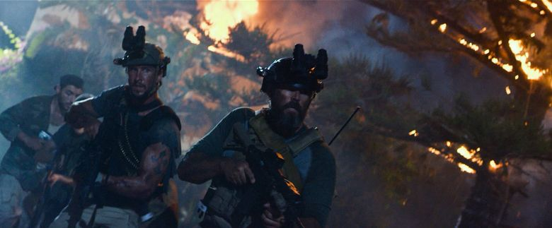 """Pablo Schreiber, left, and David Denman in """"13 Hours: The Secret Soldiers of Benghazi."""" (Credit: Dion Beebe)"""