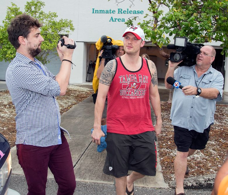 Singer Nick Carter is surrounded by media  after being released on $1,500 bond from the Monroe County Detention Center in Key West, Fla., Jan. 14, 2016. Carter was charged with misdemeanor battery.(Rob O' Neal/Key West Citizen via AP)MIAMI HERALD OUT