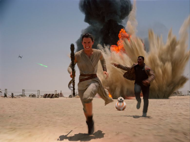 """This photo provided by Disney shows Daisey Ridley as Rey, left, and John Boyega as Finn, in a scene from the new film, """"Star Wars: The Force Awakens,"""" directed by J.J. Abrams. On Wednesday, Jan. 20, 2016, The Walt Disney Co. announced that the new release date for, """"Star Wars: Episode VIII"""" will be Dec. 15, 2017. (Film Frame/Disney/Lucasfilm via AP)"""