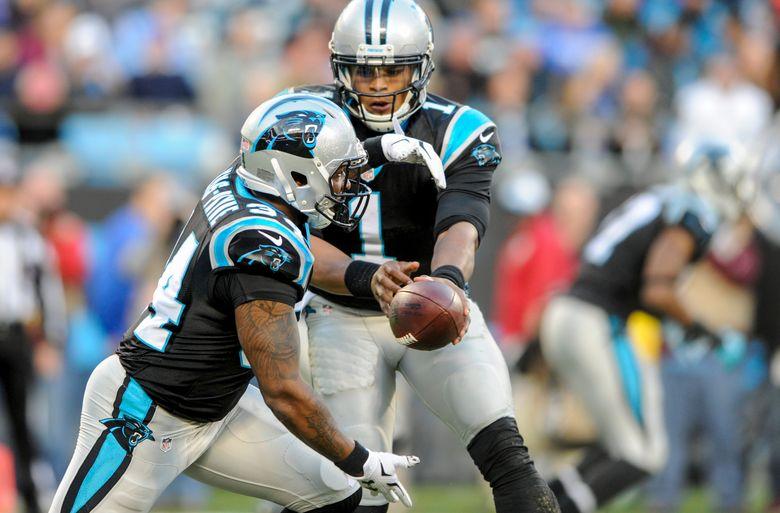 Carolina Panthers quarterback Cam Newton (1) hands the ball off to running back Cameron Artis-Payne (34) in their final game of a 15-1 regular season.  (Mike McCarn/AP)