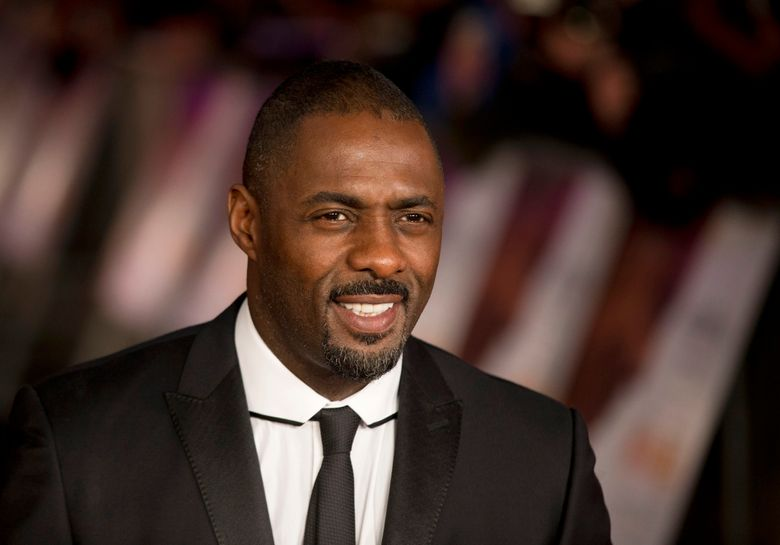 """FILE – In this Thursday, Dec. 5, 2013 file photo, British actor Idris Elba who plays Nelson Mandela in the movie """"Mandela: Long Walk to Freedom"""", poses for photographers in London. In a speech Monday Jan. 18, 2016 told an audience at Parliament that Britain was successful, diverse and multicultural but a lack of diversity in films and television is not just an American problem. (AP Photo/Matt Dunham, File)"""