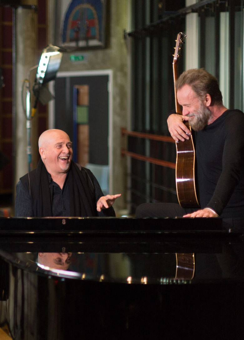 """In this image provided by Peter Gabriel Ltd, on Monday Jan. 18, 2016 British musicians Peter Gabriel, left, and Sting, at the Real World Studios in Box, England on Monday Jan. 4, 2016. Sting and Peter Gabriel are joining forces, bands and songs for a joint headline tour across North America and Canada. The artists will perform each other's songs for a tour that they hope will have a playful vibe. They joke that they'll be making all decisions by playing the game """"Rock, Paper, Scissors"""" -the name of the tour.(York Tillyer via AP) MANDATORY CREDIT"""