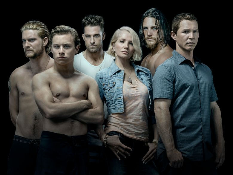 """This image released by TNT shows the cast of the new series """"Animal Kingdom,"""" starring Ellen Barkin, from row center, as the matriarch of a crime family. Kevin Reilly has begun the process of transforming the Turner Networks of TBS and TNT from a home for television comfort food into what he hopes is a destination for buzzy, edgy fare that can compete on the same turf as the AMC, Netflix and HBOs of the world. (Michael Muller/TNT via AP)"""