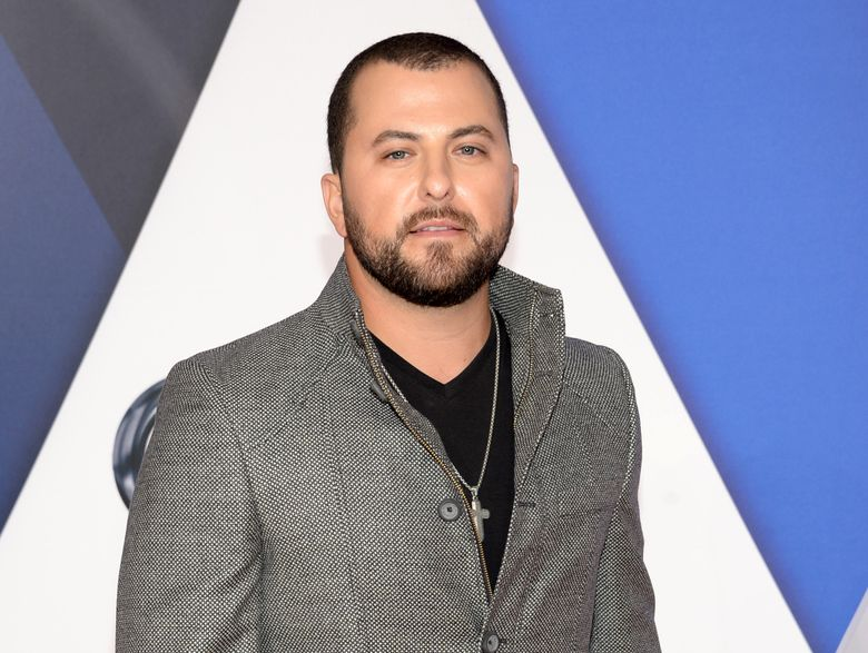 """FILE – In this Nov. 4, 2015 file photo, Tyler Farr arrives at the 49th annual CMA Awards at the Bridgestone Arena in Nashville, Tenn. Farr is cancelling upcoming shows to rest his voice after having surgery to remove a polyp on his vocal chords. In a statement released Wednesday, Jan. 27, 2016, from his label, the """"Redneck Crazy"""" singer was diagnosed after getting a severe case of bronchitis at the end of last year. (Photo by Evan Agostini/Invision/AP, FIle)"""