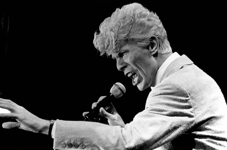 David Bowie performed several times in the Seattle area over the years. He is shown in a 1983 concert at the Tacoma Dome. (Greg Gilbert/The Seattle Times)