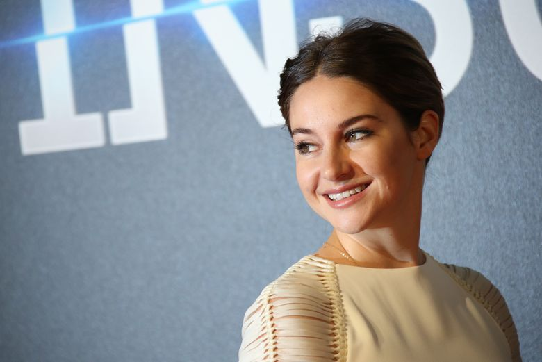 """FILE- In this March 11, 2015, file photo, Actress Shailene Woodley poses for photographers upon arrival at a central London cinema for the World Premiere of """"Insurgent"""". Woodley and Alexander Skarsgard are part of a new HBO project, """"Big Little Lies,"""" HBO said Tuesday, Jan. 5, 2016. (Photo by Joel Ryan/Invision/AP, File)"""