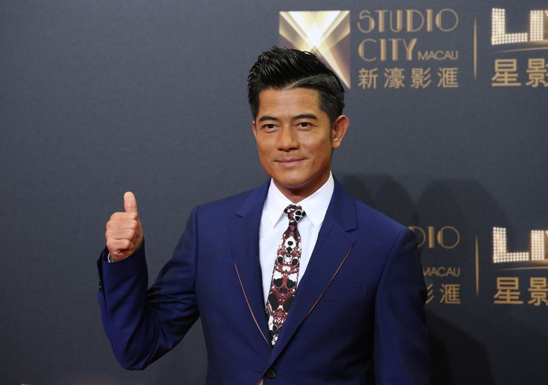 """FILE – In this Tuesday, Oct. 27, 2015, file photo, Hong Kong actor-singer Aaron Kwok poses on the red carpet of the opening ceremony for the Studio City project in Macau. A leading 13 nominations went to """"Port of Call,"""" a thriller about a detective looking into a heinous crime that tore apart two families and is loosely based on a real Hong Kong crime at the Hong Kong Film Awards. It's up for best film, best actor for Hong Kong superstar Aaron Kwok and best director for Philip Yung, for whom """"Port of Call"""" was his third feature.   (AP Photo/Kin Cheung)"""