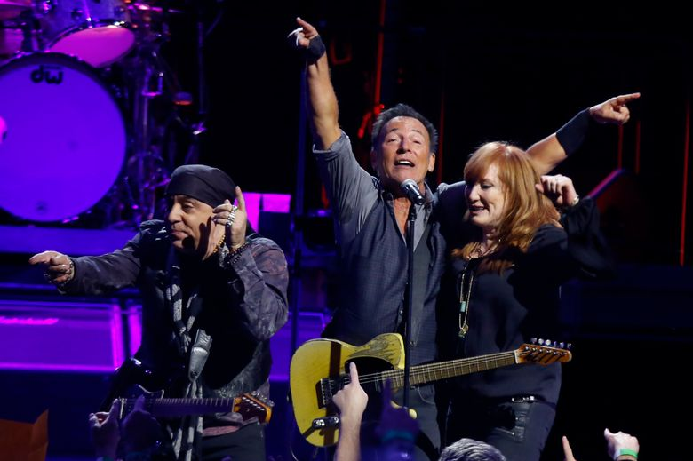 FILE – In this Jan. 16, 2016 file photo, Bruce Springsteen, center, performs with Patti Scialfa, right, and Stevie Van Zandt and the rest of the East Street Band in the first stop of his River Tour  in Pittsburgh. Springsteen and the E Street Band said their New York City show canceled because of the snowstorm will now take place in March. He was originally supposed to perform his first of two shows at Madison Square Garden on Sunday, Jan. 24. The show was canceled and will now take place at the famed venue on March 28.  (AP Photo/Keith Srakocic, File)