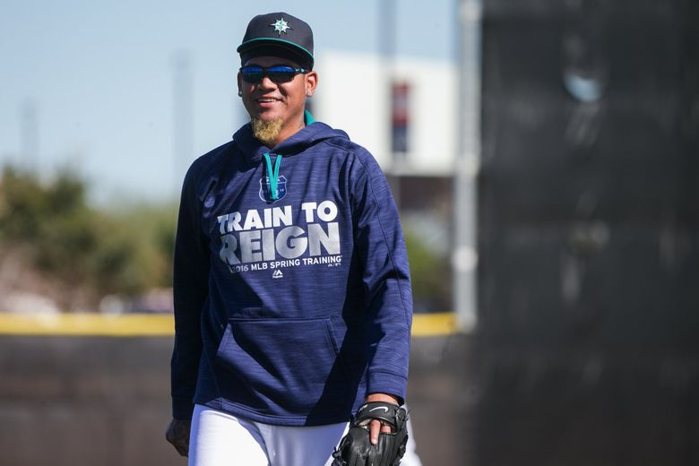 Pitcher Felix Hernandez smiles as pitchers and catchers warm up at Seattle Mariners spring training in Peoria, Arizona, Wednesday February 24, 2016. (Bettina Hansen / The Seattle Times)