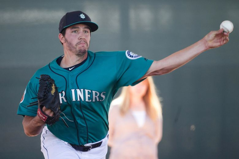 Pitcher Danny Hultzen throws in the bullpen at Seattle Mariners spring training. (Bettina Hansen / The Seattle Times)