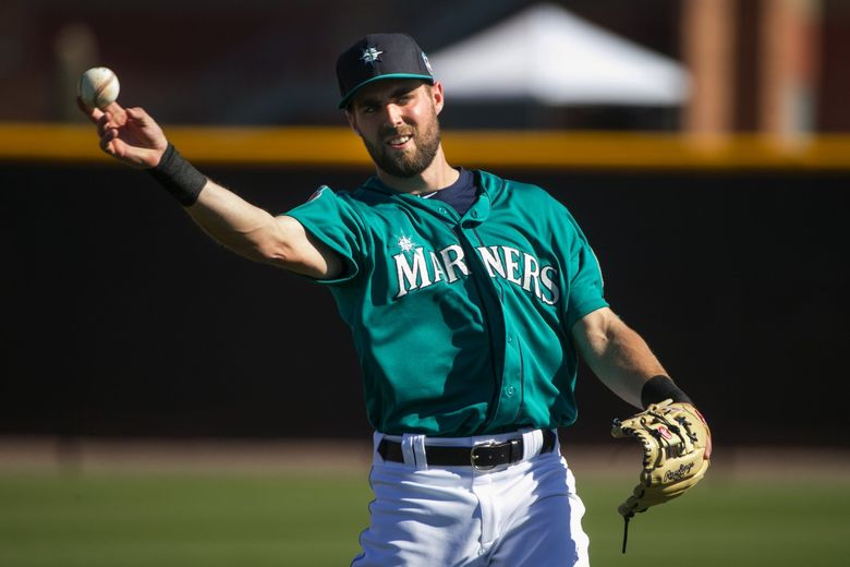 Shortstop Chris Taylor does infield drills at Seattle Mariners spring training.  (Bettina Hansen / The Seattle Times)