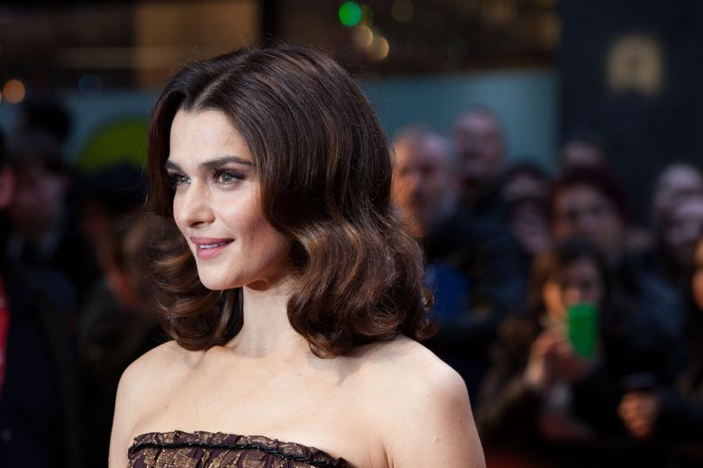 """FILE – In this Oct. 15, 2015 file photo, Rachel Weisz poses for photographers upon arrival at the premiere of the film 'Youth', as part of the London film festival in London. The Public Theater said Thursday, Feb. 25, 2016,  Weisz will appear in a revival of David Hare's """"Plenty,"""" directed by Tony nominee David Leveaux. It will be presented during the 2016-2017 season. Exact dates were not announced. (Photo by Grant Pollard/Invision/AP)"""