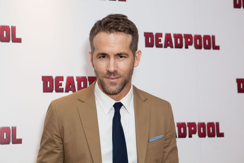 FILE – In a Oct. 28, 2016 file photo, actor Ryan Reynolds poses for photographers upon arrival at a fan screening of the film 'Deadpool', in central London. Reynolds will be watching Sunday's Super Bow, he's just not sure which team he wants to win. The Canadian actor said he's a fan of both the Carolina Panthers and Denver Broncos.(Photo by Grant Pollard/Invision/AP, File)