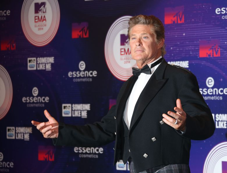 """FILE – In this Nov. 9, 2014 file photo, actor David Hasselhoff poses for photographers upon arrival at the 2014 MTV European Music Awards in Glasgow. Hasselhoff will be making a big splash on TV next month. To mark the American debut of his U.K. series, """"Hoff the Record,"""" on AXS TV, the channel says it will salute the """"Baywatch"""" star with a March 26, 2016, mini-marathon starting at 3 p.m. EST. (Photo by Joel Ryan/Invision/AP, File)"""