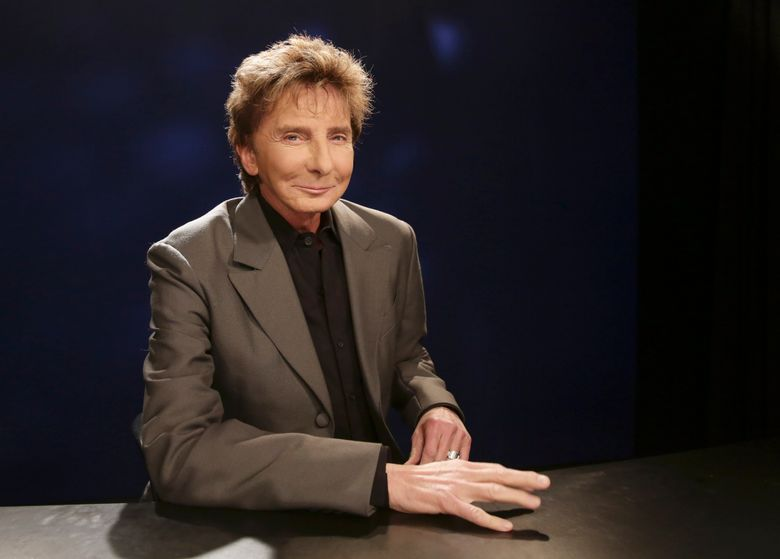 FILE – In this Oct. 27, 2014 file photo, singer-songwriter and producer Barry Manilow poses for a photograph during an interview in New York. Manilow has been forced to postpone two concerts following a rough week of oral surgery. Manilow had surgery twice earlier this week, and still managed to make a concert in Memphis on Wednesday. But after that, he was brought back to Los Angeles for surgery Friday when complications developed. (AP Photo/Kathy Willens, File)
