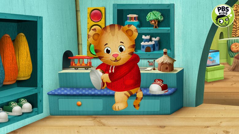 """In this image provided by courtesy of PBS and The Fred Rogers Company, """"Daniel Tiger's Neighborhood"""" is among the PBS KIDS programs that will be available through new 24/7 multiplatform kids services to be launched by PBS later in 2016. (PBS/The Fred Rogers Company via AP)"""