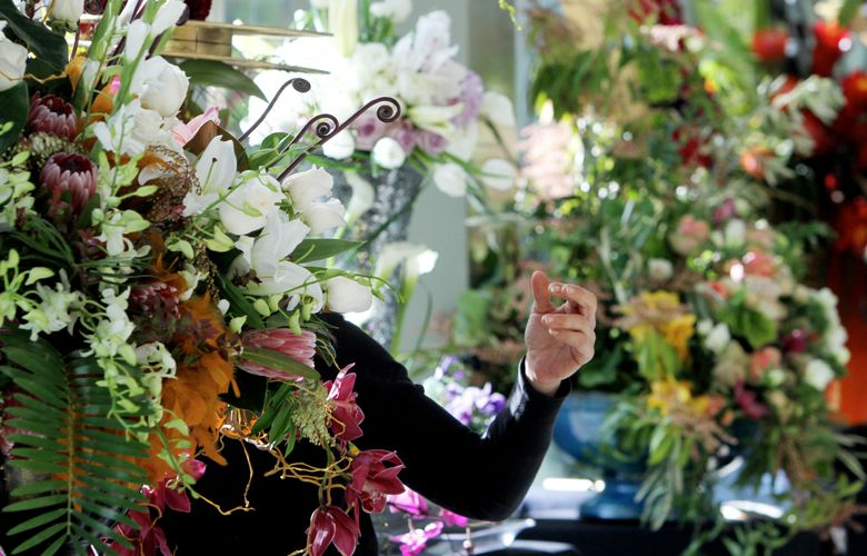 Exhibitors make final preparations at the 2016 Northwest Flower & Garden Show. This year's floral extravaganza runs Wednesday-Sunday, Feb. 17-21.  (Ken Lambert/The Seattle Times)