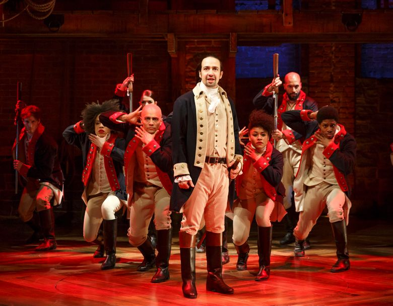 """This image released by The Public Theater shows Lin-Manuel Miranda, foreground, with the cast during a performance of """"Hamilton,"""" in New York. The cast will perform at the Grammy Awards live via satellite from the Richard Rodgers Theatre in New York on Feb. 15.  (Joan Marcus/The Public Theater via AP)"""