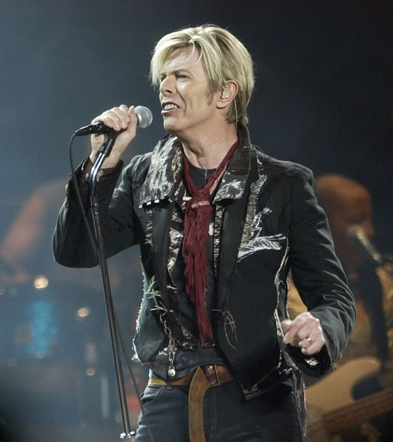 """FILE – In this Dec. 15, 2003 file photo, singer/songwriter David Bowie launches his United States leg of his worldwide tour called """"A Reality Tour,"""" in New York. The Grammys announced Tuesday, Feb. 2, 2016, that Lady Gaga will perform a """"multisensory tribute"""" to Bowie at the Feb. 15 ceremony in Los Angeles. Bowie died, Jan. 10, after battling cancer for 18 months. He was 69. (AP Photo/Kathy Willens, File)"""