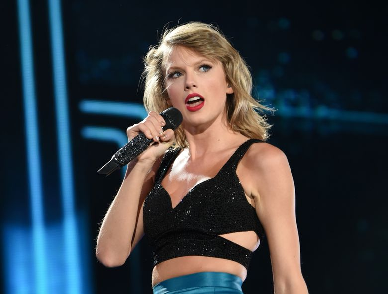 """FILE – In this July 10, 2015 file photo, singer Taylor Swift performs during her """"1989"""" world tour at MetLife Stadium in East Rutherford, N.J.  Swift leads the 2016 iHeartRadio Music Awards with eight nominations, followed by The Weeknd with seven nominations. The nominations were announced Tuesday, Feb. 9, 2016 by iHeartMedia and Turner. (Photo by Evan Agostini/Invision/AP, File)"""