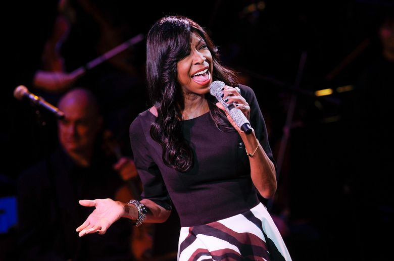 """FILE – In this March 2, 2015 file photo, singer Natalie Cole performs at """"An Evening of SeriousFun Celebrating the Legacy of Paul Newman"""" in New York. The sister of Natalie Cole said she was disappointed by the Recording Academy's tribute to the late singer during Monday's 58th annual Grammy Awards. The telecast featured a clip from the 1992 Grammys performance of Natalie Cole singing in sync with her father, Nat King Cole, who appeared in video, at the conclusion of the """"In Memoriam"""" tribute to musicians and artists who died in the previous year. (Photo by Evan Agostini/Invision/AP, File)"""