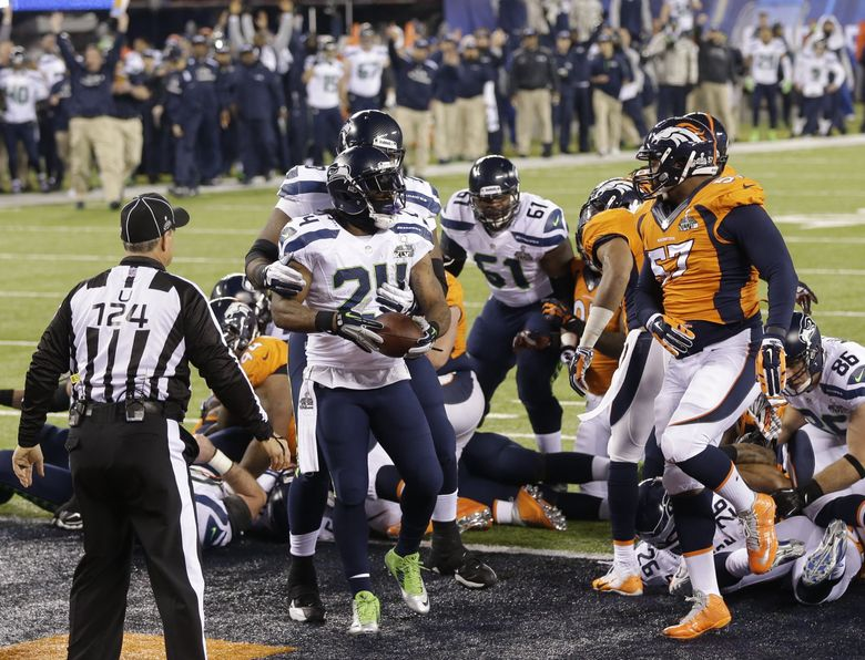 Running back Marshawn Lynch (24) scores a touchdown as the Seahawks beat the Denver Broncos, 43-8, in Super Bowl XLVIII. (Bettina Hansen/The Seattle Times)