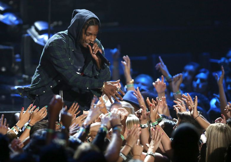 """FILE – In this Sunday, Aug. 30, 2015, file photo, A$AP Rocky performs at the MTV Video Music Awards at the Microsoft Theater in Los Angeles. Rapper A$AP Rocky says he came away unhurt during a recent attack on him inside a hotel elevator in New Zealand. Rocky told The Associated Press on Sunday, Feb. 28, 2016, that he was in a """"fist exchange"""" that occurred Wednesday in Auckland, New Zealand. He performed that same day at Auckland's Vector Arena. (Photo by Matt Sayles/Invision/AP, File)"""