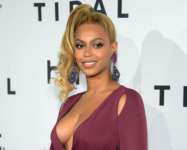 """FILE – In this Oct. 20, 2015 file photo, singer Beyonce arrives at TIDAL X: 1020 Amplified by HTC at the Barclays Center in New York. A day before her performance at Sunday's Super Bowl halftime show, Beyonce has dropped a new song. Beyonce released """"Formation"""" on Saturday, Feb. 6, 2016 as a free download on her artist page for the streaming service, Tidal, which she co-owns with husband Jay Z, Rihanna and other artists.(Photo by Evan Agostini/Invision/AP, File)"""