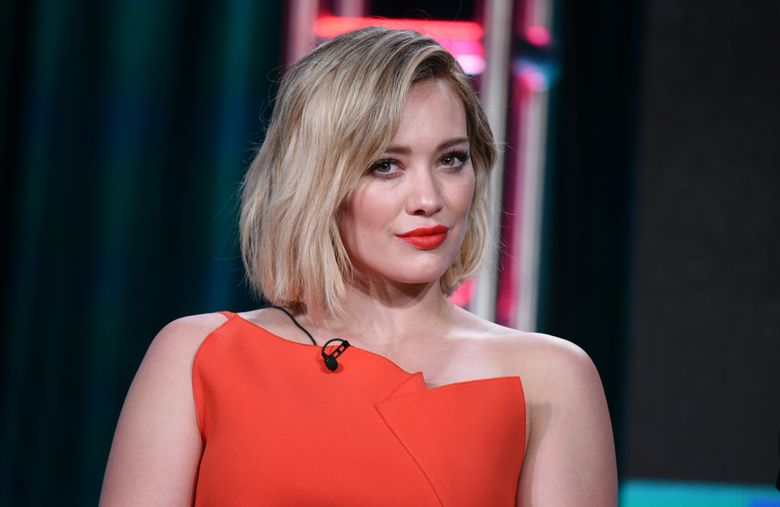 """FILE – In this Wednesday, Jan. 6, 2016 file photo, Hilary Duff speaks during the """"Younger"""" panel at the TV Land 2016 Winter TCA in Pasadena, Calif. Court records show a Los  Angeles judge finalized Duff's divorce from ex-NHL player Mike Comrie on Thursday, Jan. 28, 2016. The pair were married in 2010 and separated in 2014 and have a three-year-old son together. (Photo by Richard Shotwell/Invision/AP, File)"""