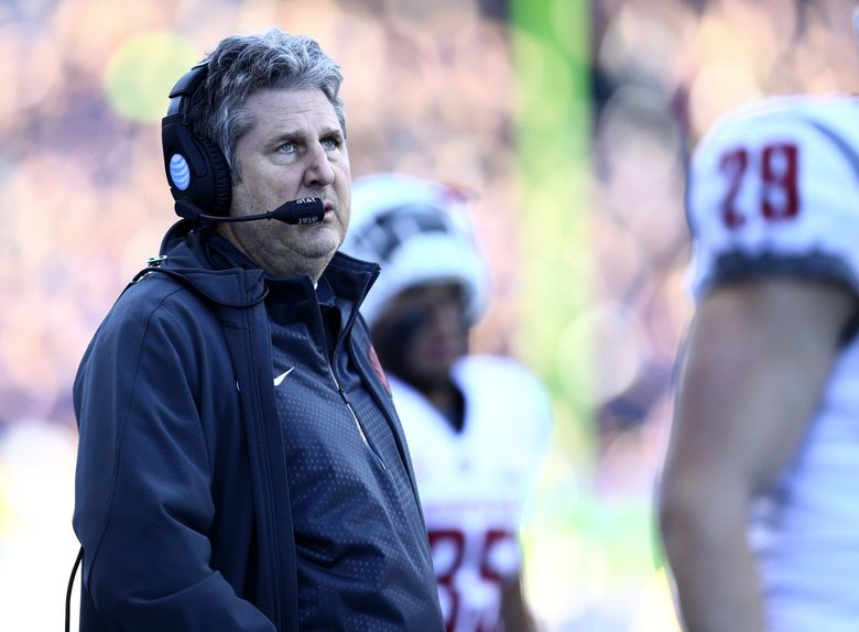 Washington State head coach Mike Leach looks up at the scoreboard as the Cougars trail 17-3 during the first half of the108th Apple Cup at Husky Stadium on Friday, Nov. 27, 2015.  (Lindsey Wasson/The Seattle Times)