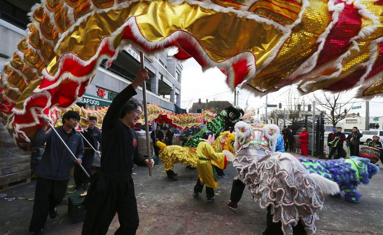 Lunar New Year — ushering in the Year of the Monkey — will be celebrated 11 a.m. to 4 p.m. Feb. 13 at Hing Hay Park in Seattle with dragon and lion dances and other activities. (Alan Berner/The Seattle Times)