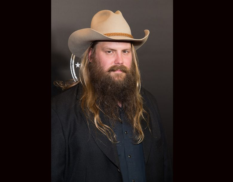 """FILE – In this Dec. 5, 2015 file photo, Chris Stapleton attends the Imagine: John Lennon 75th Birthday Concert at Madison Square Garden in New York. Stapleton earned two extra nominations from the Academy of Country Music Awards, making him the leading nominee with seven nods. The ACM announced on Thursday the nominees for the song of the year and songwriter categories. Stapleton, who had five nominations in previously announced categories, added two more for his song """"Nobody to Blame,"""" as co-writer and artist. (Photo by Charles Sykes/Invision/AP, File)"""