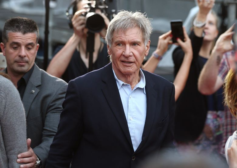 """FILE – In this December 10, 2015 file photo Harrison Ford walks during a Star Wars fan event in Sydney. Ford is in Australia to promote his latest film """"Star Wars: The Force Awakens"""". British health authorities said on Thursday Feb. 11, 2016 that criminal charges have been laid against producers of """"Star Wars: The Force Awakens"""" over an on-set accident in which Harrison Ford broke his leg. (AP Photo/Rob Griffith, File)"""