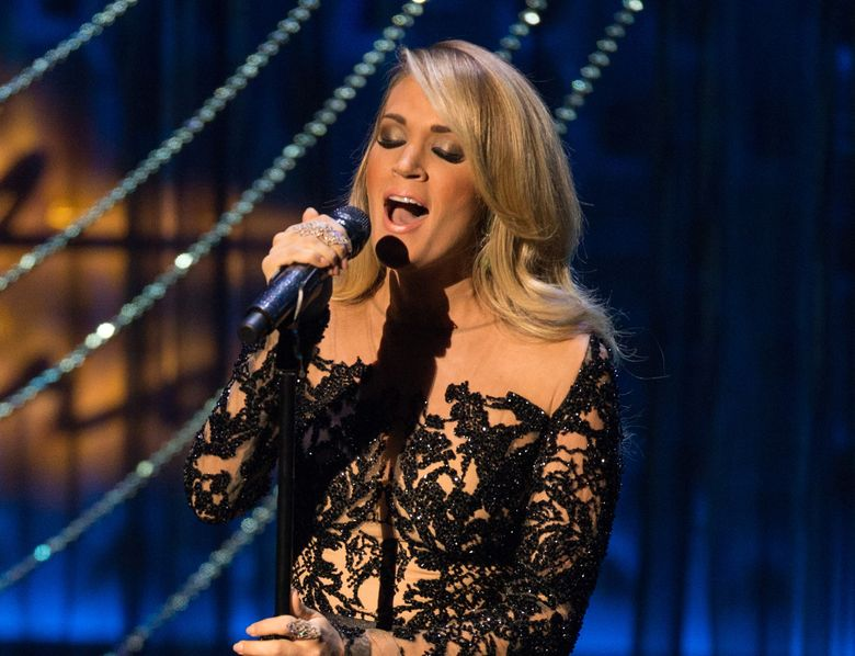 FILE – In this Dec. 2, 2015 file photo, country singer Carrie Underwood performs during the Sinatra 100 – An All-Star Grammy concert at The Wynn Las Vegas. Underwood, Kenny Chesney, Keith Urban, Florida Georgia Line and Cam are the first performers announced Thursday, Feb. 25, 2016, for the 51st annual Academy of Country Music Awards. The show will be broadcast live from the MGM Grand Garden Arena in Las Vegas on April 3 on CBS.  (Photo by Eric Jamison/Invision/AP)