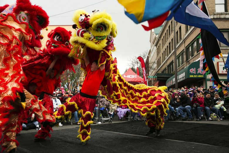 Lion dancers at the 2014 Chinese Lunar New Year celebration in the Chinatown International District. (Marcus Yam / The Seattle Times)