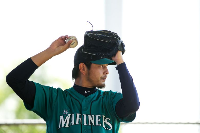 Pitcher Hisashi Iwakuma warms up in the bullpen at Seattle Mariners spring training in Peoria, Arizona, Tuesday March 1, 2016. (Bettina Hansen / The Seattle Times)