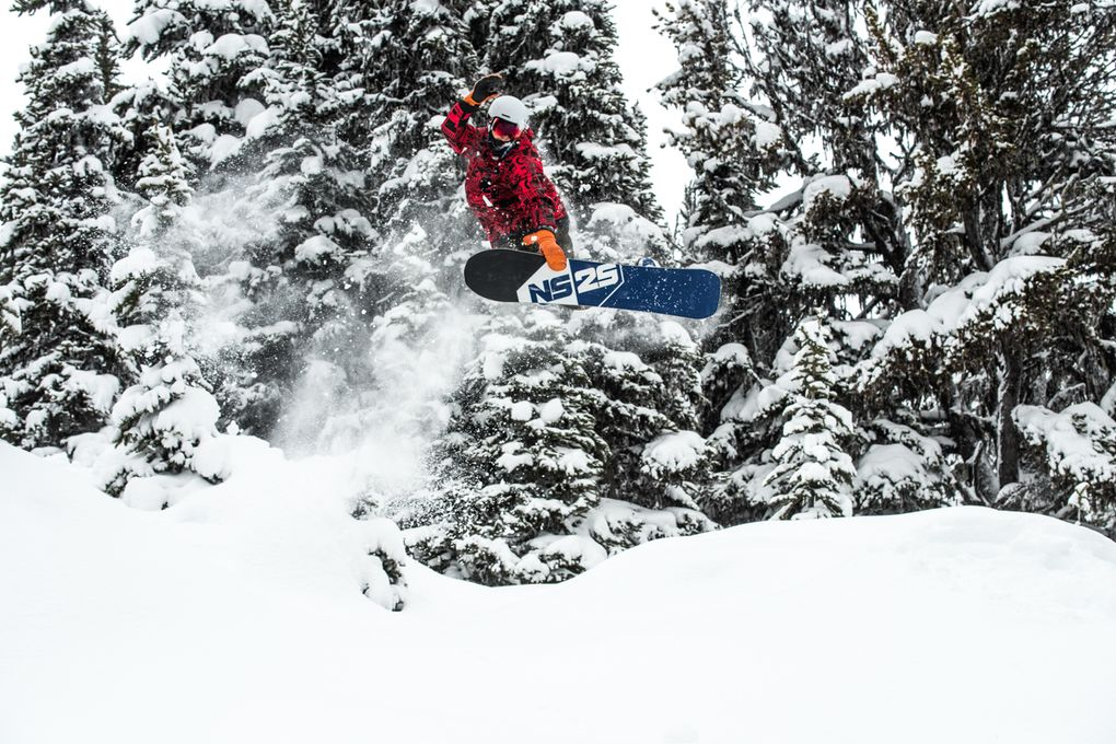 A snowboarders catches air at Whistler-Blackcomb Resort. Photo courtesy of Logan Swayze at Coast Mountain Photography and Whistler-Blackcomb Resort.