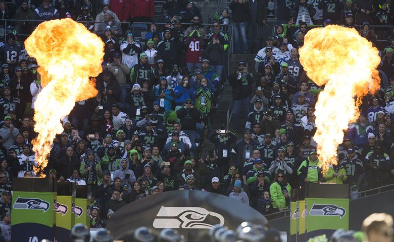 Fans cheer as the Seahawks are introduced before taking on the 49ers on Nov. 22, 2015, at CenturyLink Field. (Mike Siegel / The Seattle Times)