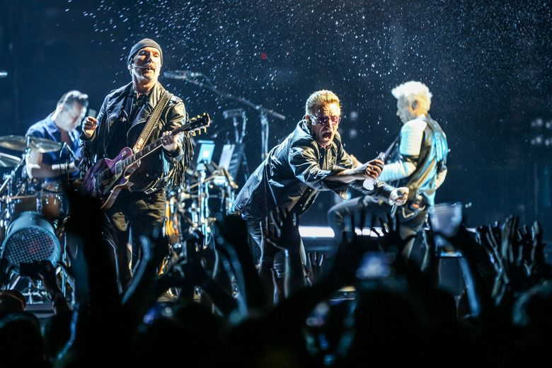 FILE – In this May 26, 2015 file photo, Larry Mullen Jr., from left, The Edge, Bono and Adam Clayton of U2 perform at the Innocence + Experience Tour at The Forum in Inglewood, Calif. (Photo by Rich Fury/Invision/AP, File)