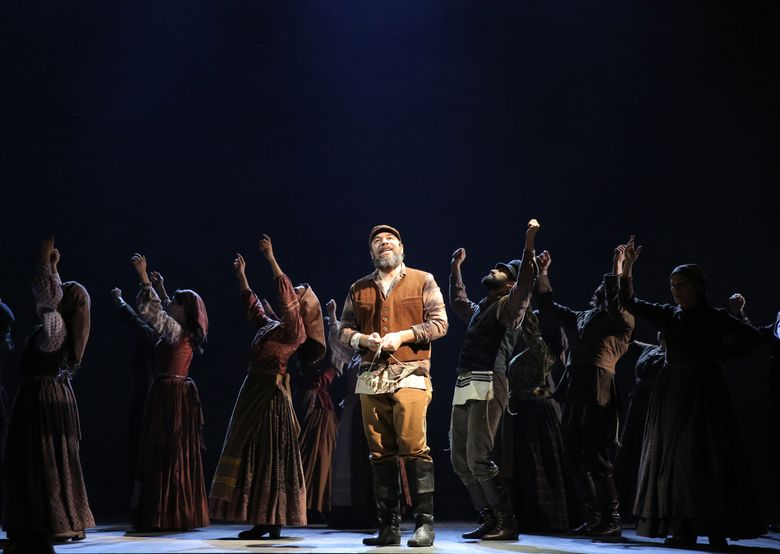 """In this undated photo provided Jeffrey Richards Associates, Danny Burstein, center, as Tevye, and cast rehearse """"Fiddler on the Roof"""" in New York. The cast recorded an album of the Broadway revival on the Broadway Records label and will have its worldwide release on March 18. (Joan Marcus/Jeffery Richards Associates via AP) MANDATORY CREDIT"""