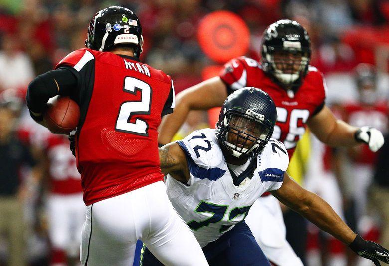 Seahawks defensive end Michael Bennett, right, eyes Falcons quarterback Matt Ryan for a sack Nov. 10, 2013, the last time Seattle played Atlanta. (John Lok / The Seattle Times)