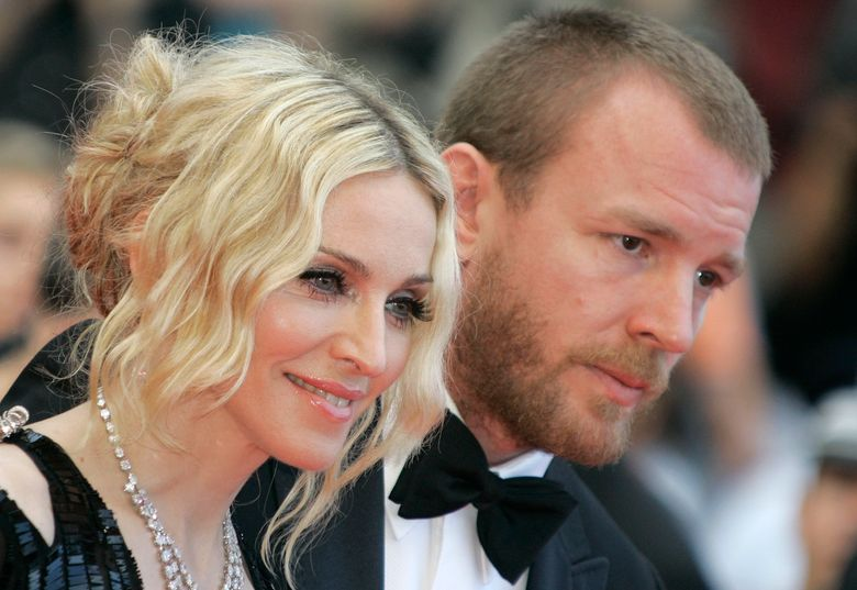 """FILE – This is a  Wednesday, May 21, 2008 file photo of Madonna and  her then husband director Guy Ritchie as they arrive for the premiere of the film """"I Am Because We Are"""" at the 61st international Cannes film festival, in Cannes France. A British judge is analyzing legal issues stemming from a dispute between Madonna and her ex-husband Guy Ritchie over custody of their 15-year-old son Rocco.  Judge Alistair MacDonald said Thursday March 10, 2016 the fact that case is being analyzed can be reported but that no further details can be published. (AP Photo/Lionel Cironneau)"""