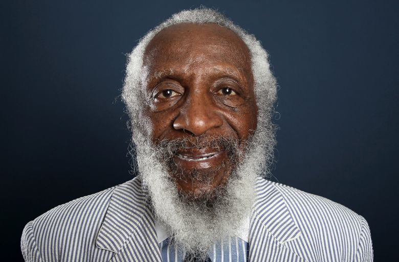 """FILE – In this July 21, 2012 file photo, comedian and activist Dick Gregory, from the upcoming documentary film """"Soul Food Junkies,"""" poses for a portrait during the PBS TCA Press Tour in Beverly Hills, Calif. A play about Gregory will open off-Broadway this spring starring Joe Morton and with an original song by John Legend. """"Turn Me Loose,"""" by Gretchen Law will play the Westside Theatre starting May 3, 2016, under the direction of John Gould Rubin. (Photo by Matt Sayles/Invision/AP, File)"""