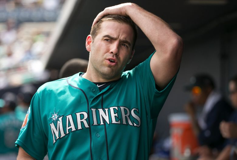 Pitcher Nathan Karns takes a deep breath in the dugout before starting on the mound as the Seattle Mariners play the San Diego Padres at Peoria Stadium for their second game of Cactus League play in Peoria, Arizona, Wednesday March 2, 2016. (Bettina Hansen/The Seattle Times)