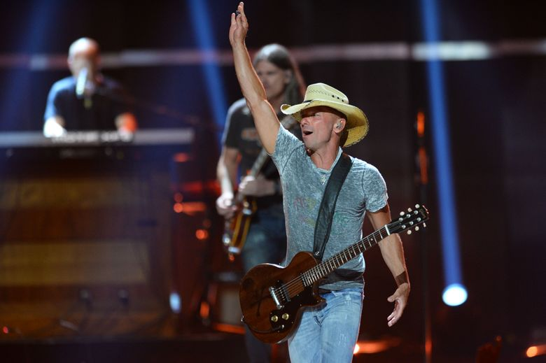 """FILE – In this Sept. 18, 2015 file photo, Kenny Chesney performs at Day 1 of the 2015 iHeartRadio Music Festival at the MGM Grand Garden Arena  in Las Vegas.  Chesney is getting his own """"No Shoes Radio"""" channel on satellite radio's SiriusXM, seeking more exposure for an online venture he started in 2008 to share music with fans.  SiriusXM said Tuesday, March 29, 2016,  that the service will launch on April 12. (Photo by Al Powers/Powers Imagery/Invision/AP)"""