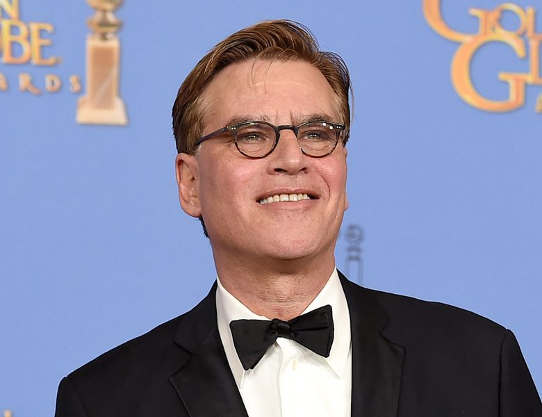 """FILE – In this Jan. 10, 2016 file photo, Aaron Sorkin poses in the press room with the award for best screenplay – motion picture for """"Steve Jobs"""" at the 73rd annual Golden Globe Awards in Beverly Hills, Calif. Sorkin is bringing a live presentation of his drama """"A Few Good Men"""" to NBC next year, the network announced Wednesday, March 30. Casting and an airdate in early 2017 will be announced later, the network said. (Photo by Jordan Strauss/Invision/AP, File)"""
