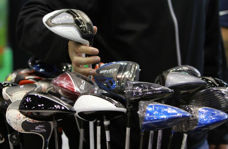 An attendee peruses golf clubs at last year's Seattle Golf and Travel show. This year's event runs Friday through Sunday, March 4-6. The Seattle Bike Show and Travel, Adventure and Gear Expo will also be at CenturyLink Field Event Center on Saturday and Sunday (March 5-6).  (Ken Lambert/The Seattle Times)