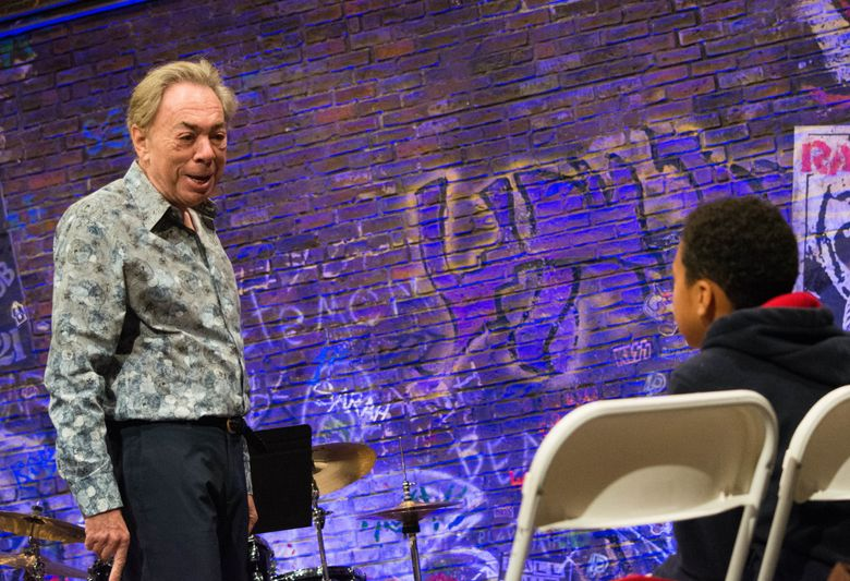 """This image released by DKC/O&M shows Andrew Lloyd Weber during an open audition for the musical """"The School of Rock."""" Last week, they held open auditions that drew a few hundred kids aged 9-12 to the Winter Garden Theatre stage. (Timmy Buple/DKC/O&M via AP)"""